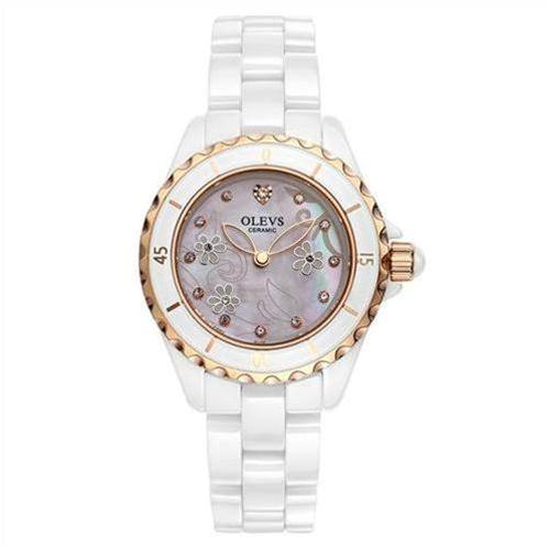 Đồng hồ nữ mặt tròn cách điệu Olevs